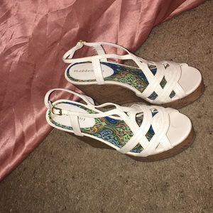 White wedged heels.